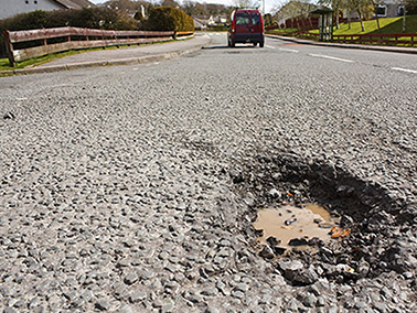 A few tips on how to limit or avoid potholes damages to your car so you don't have to make a claim.